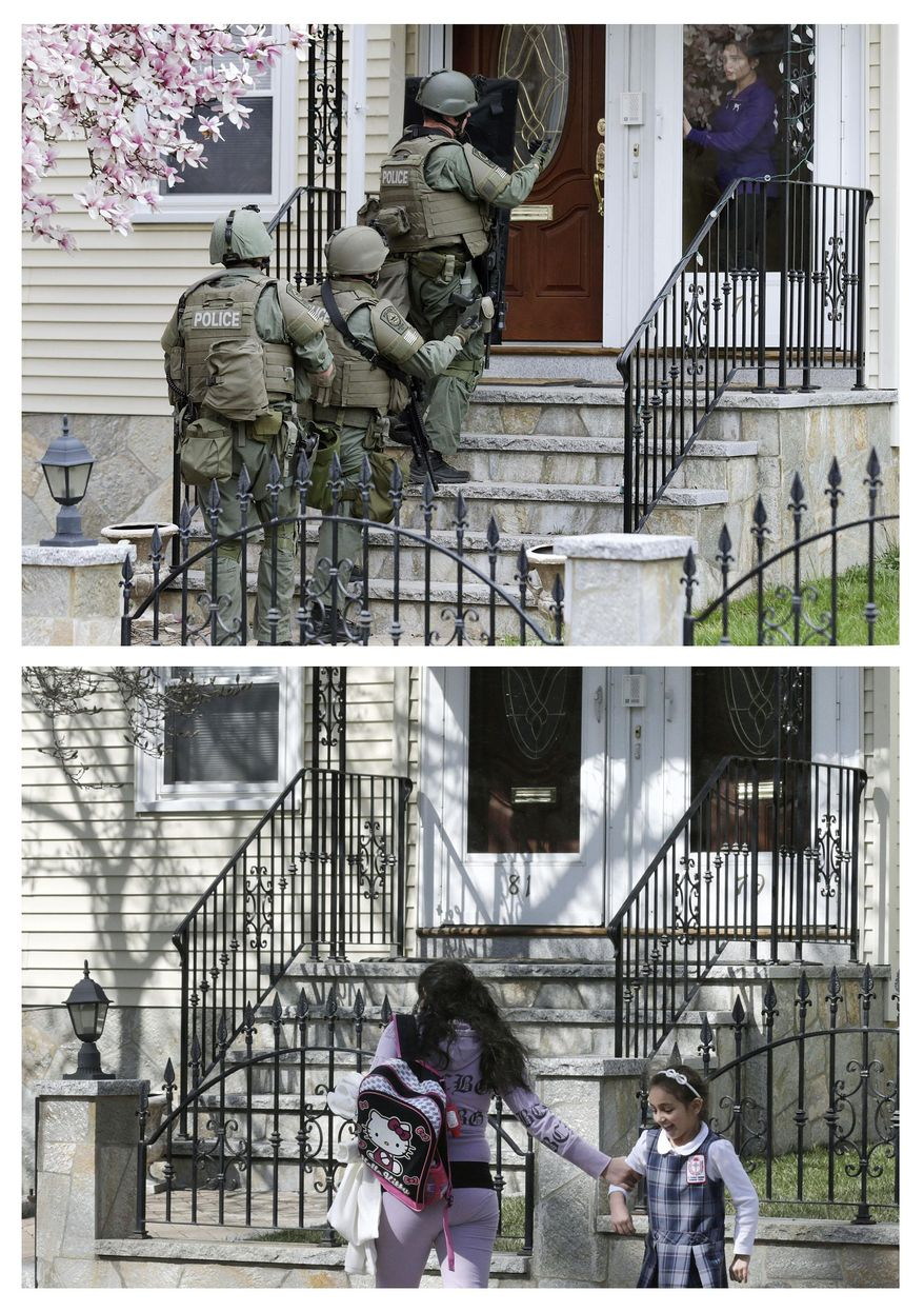 This combination of April 19, 2013 and April 9, 2014 photos show police going door-to-door as they searched for Boston Marathon bombing suspect Dzhokhar Tsarnaev in Watertown, Mass., and a child walking past the same home after school almost a year later.  (AP Photo/Charles Krupa)