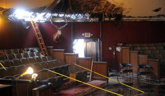 An interior view showing the remains of the Elks Lodge in the San Pedro section of Los Angles from a fire that destroyed most of a lodge on Tuesday, April 15, 2014. Much of the 34,000-square-foot structure was gutted, but crews managed to save the auditorium. (AP Photo/The Daily Breeze, Brad Graverson)