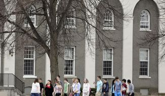 Accepted students and their parents tour Union College on Monday, April 14, 2014, in Schenectady, N.Y. Tiny Union, enrollment 2,200, defeated Minnesota, enrollment 48,000, Saturday for its first NCAA hockey title. (AP Photo/Mike Groll)