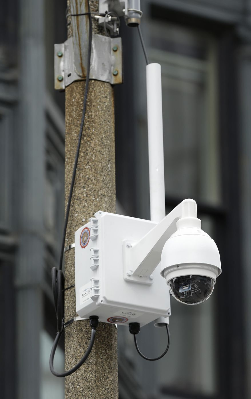 A surveillance camera is attached to a light pole along Boylston Street near the finish line of the Boston Marathon, Monday, April 14, 2014, in Boston. A year after twin pressure cooker bombs shattered the marathon and paralyzed the area for days, federal prosecutors say they have a trove of evidence ready to use against the surviving suspect, but many questions remain. (AP Photo/Steven Senne)