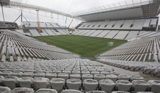 A general view of the still unfinished Itaquerao stadium in Sao Paulo, Brazil, Tuesday, April 15, 2014. The stadium that will host the World Cup opener match between Brazil and Croatia on June 12, will hold nearly 70,000 people in the opener, but after the World Cup its capacity will be reduced to about 45,000. (AP Photo/Andre Penner)