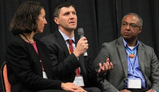 New Mexico Environment Department Secretary Ryan Flynn, center, discusses water quality issues around the state as Laguna Pueblo Gov. Richard Luarkie and Luara McCarthy of The Nature Conservancy listen during a town hall in Albuquerque, N.M. on Tuesday, April 15, 2014. Hundreds of state officials, water managers, researchers and others were participating in the two-day meeting with the goal of developing a series of recommendations as New Mexico grapples with drought. (AP Photo/Susan Montoya Bryan)