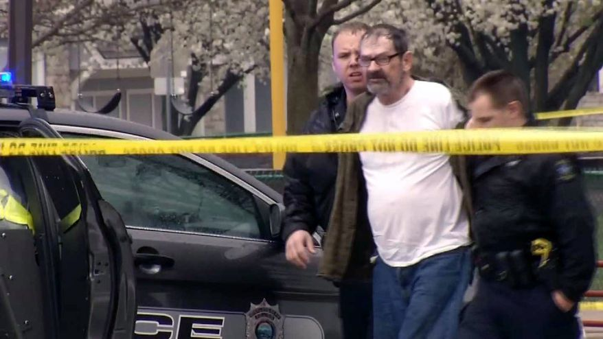 FILE - In this April 13, 2014 file image taken from video provided by KCTV-5, Frazier Glenn Cross is escorted by police in an elementary school parking lot in Overland Park, Kan. Authorities said Tuesday, April 15, that Cross has been charged with one count of capital murder for the deaths of a 14-year-old boy and his grandfather outside the Jewish Community Center of Greater Kansas City on Sunday. Cross also faces one count of first-degree, premeditated murder for the death of a woman who was gunned down while visiting her mother at a nearby retirement complex. (AP Photo/KCTV-5, File) MANDATORY CREDIT