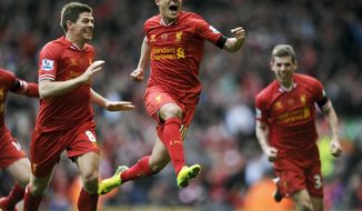 10ThingstoSeeSports - Liverpool's Philippe Coutinho, center, celebrates with teammate Steven Gerrard, left, after he scored the third goal of the game for his side during their English Premier League soccer match against Manchester City at Anfield in Liverpool, England, Sunday, April 13, 2014. (AP Photo/Clint Hughes, File)