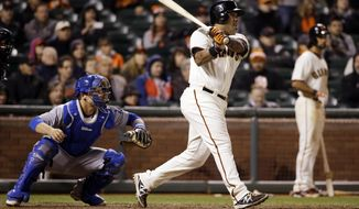 San Francisco Giants' Hector Sanchez singles in the game-winning run during the 12th inning of a baseball game against the Los Angeles Dodgers on Wednesday, April 16, 2014, in San Francisco. San Francisco won 3-2.  (AP Photo/Marcio Jose Sanchez)