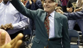 Milwaukee Bucks owner Herb Kohl is acknowledged by fans during the first half of an NBA basketball game against the Atlanta Hawks, Wednesday, April 16, 2014, in Milwaukee. (AP Photo/Morry Gash)