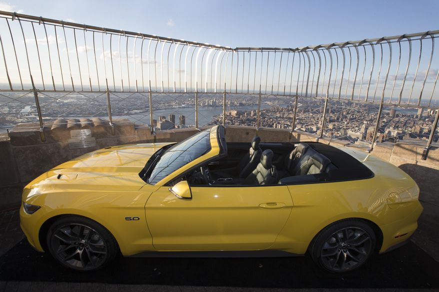 Ford Motor Co. introduces the all-new 2015 Mustang convertible on the 86th floor observation deck of the Empire State Building during the New York International Auto Show, Wednesday, April 16, 2014, in New York. (AP Photo/John Minchillo)