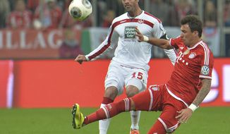 Bayern's Mario Mandzukic of Croatia right, and Kaiserslautern's Marc Torrejon Moyachallenge challenge for the ball during the German soccer cup (DFB Pokal) semifinal  match between FC Bayern Munich and FC Kaiserslautern in the Allianz Arena in Munich, Germany, on Wednesday, April 16. 2014. (AP Photo/Kerstin Joensson)