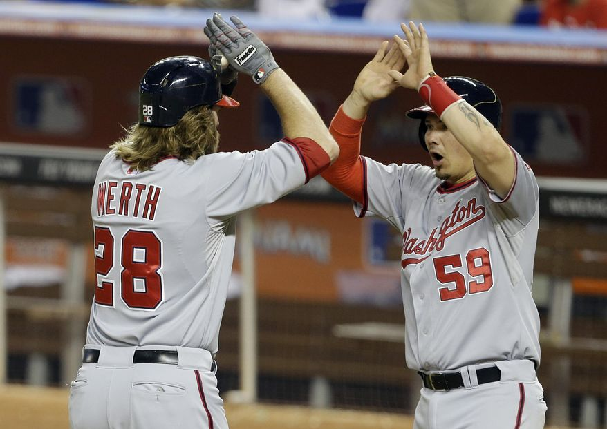 Washington Nationals' Jayson Werth (28) is met by Jose Lobaton (59) at the plate after they scored on a three-run home run by Werth during the sixth inning of the MLB National League baseball game against the Miami Marlins, Wednesday, April 16, 2014, in Miami. (AP Photo/Lynne Sladky)
