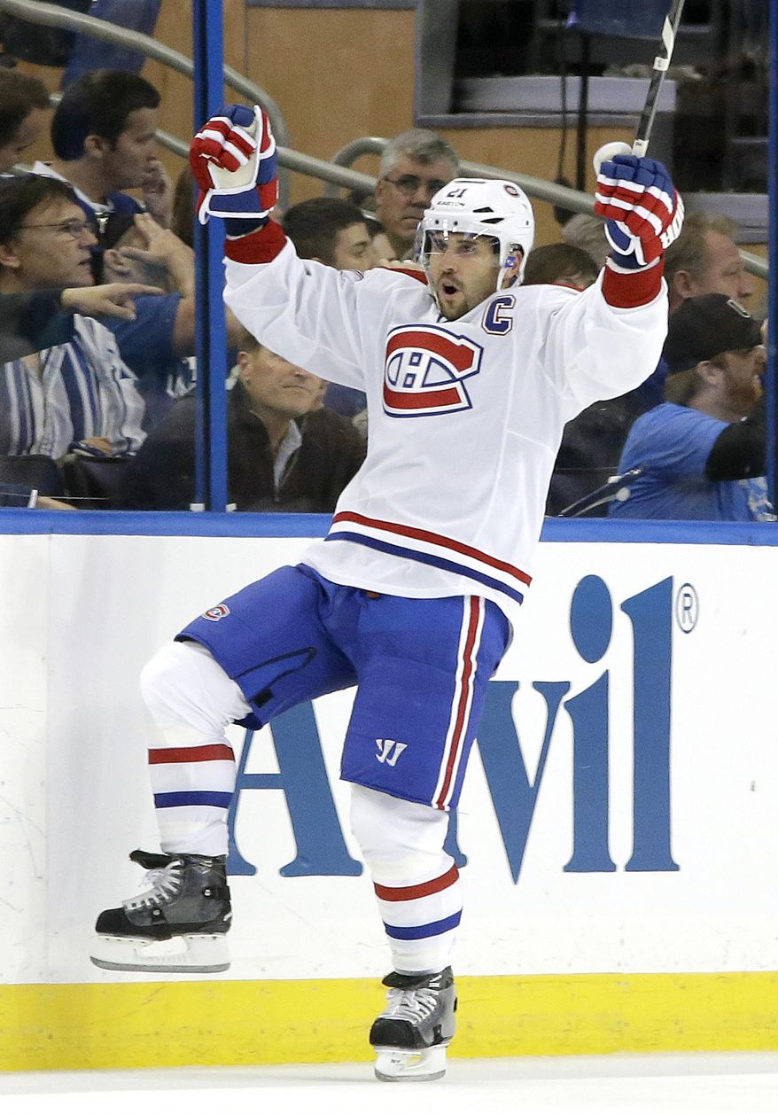 Montreal Canadiens right wing Brian Gionta celebrates after his short-handed goal against the Tampa Bay Lightning during the second period of Game 1 of a first-round NHL hockey playoff series on Wednesday, April 16, 2014, in Tampa, Fla. (AP Photo/Chris O'Meara)
