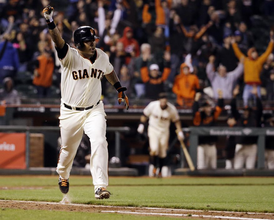 San Francisco Giants' Hector Sanchez runs down the first base line after driving in the game-winning run during the 12th inning of a baseball game against the Los Angeles Dodgers on Wednesday, April 16, 2014, in San Francisco. San Francisco won 3-2.  (AP Photo/Marcio Jose Sanchez)
