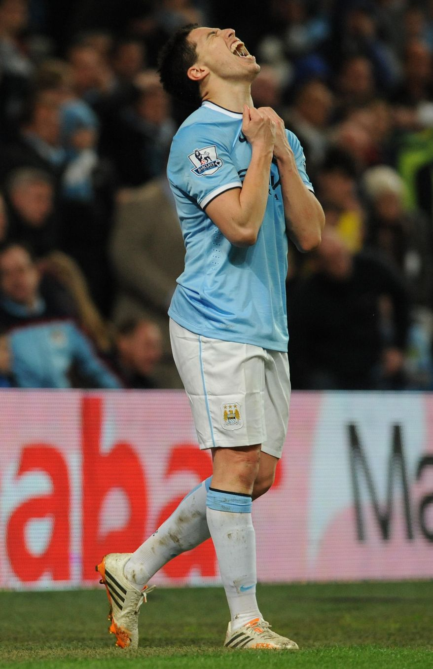 Manchester City's Samir Nasri grimaces after missing a goal scoring opportunity during the English Premier League soccer match between Manchester City and Sunderland at The Etihad Stadium, Manchester, England, Wednesday, April 16, 2014. (AP Photo/Rui Vieira)