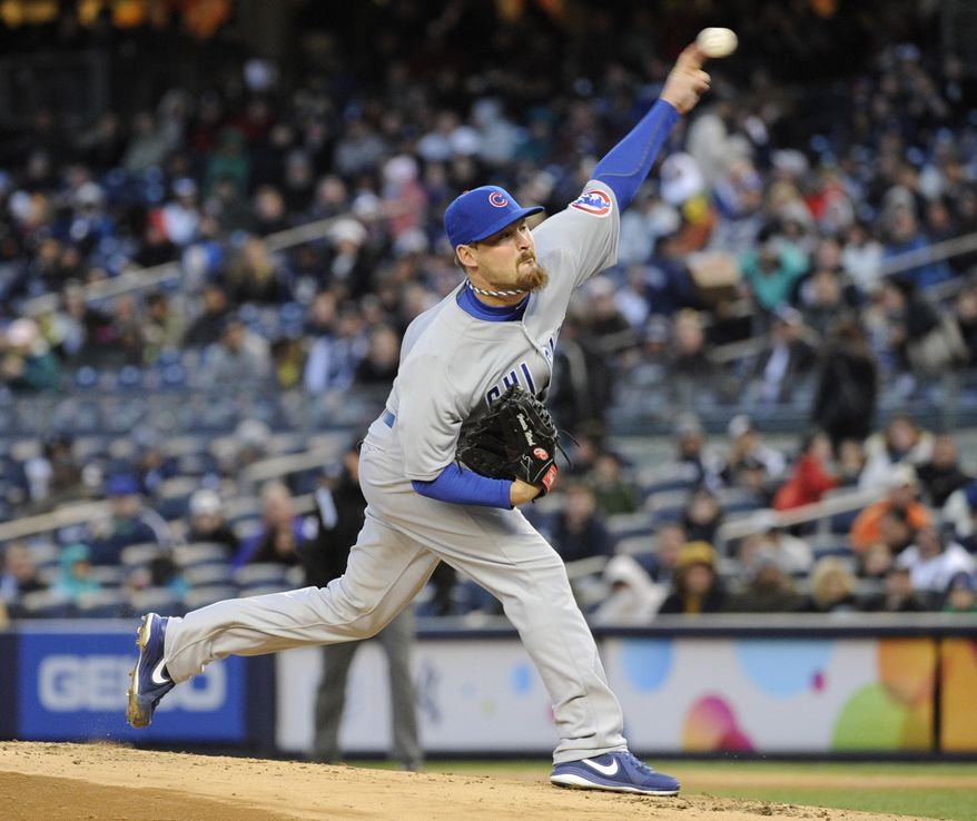 Chicago Cubs pitcher Travis Wood delivers the ball to the New York Yankees during the first inning of Game 2 of an interleague baseball doubleheader on Wednesday, April 16, 2014, at Yankee Stadium in New York. (AP Photo/Bill Kostroun)