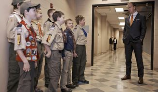 ** FILE ** This Wednesday, April 16, 2014, photo provided by the Boy Scouts of America shows Peyton Manning talking to a group of Scouts before he spoke to the Boy Scouts of America's annual breakfast in Denver. (AP Photo/Boy Scouts of America, Dan Sidor)