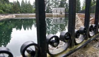 The Mount Tabor number 1 reservoir in Portland, Ore., is seen in a June 20, 2011 photo.  Portland officials said Wednesday, April 16, 2014 that they are flushing away millions of gallons of treated water for the second time in less than three years because someone urinated into a city reservoir. In June 2011, the city drained a 7.5 million-gallon reservoir at Mount Tabor in southeast Portland. This time, 38 million gallons from a different reservoir at the same location will be discarded after a 19-year-old was videotaped in the act  (AP Photo/The Oregonian, Benjamin Brink)