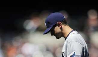 Tampa Bay Rays starting pitcher Jake Odorizzi walks off the field after the fourth inning of a baseball game against the Baltimore Orioles, Wednesday, April 16, 2014, in Baltimore. Odorizzi allowed two runs in the fourth. Baltimore won 3-0. (AP Photo/Patrick Semansky)