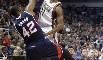 Atlanta Hawks' Elton Brand (42) and Milwaukee Bucks' Brandon Knight (11) go after a loose ball during the first half of an NBA basketball game on Wednesday, April 16, 2014, in Milwaukee. (AP Photo/Morry Gash)