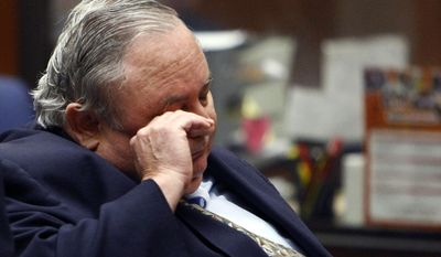 Robert Rizzo, the former city manager of Bell, Calif., rubs his eye in Los Angeles County Superior Court on Wednesday, April 16, 2014, in Los Angeles. Rizzo was sentenced to 12 years in prison and ordered to make restitution of $8.8 million in a corruption scheme that nearly bankrupted the small, blue-collar city. (AP Photo/Los Angeles Times, Al Seib, Pool)