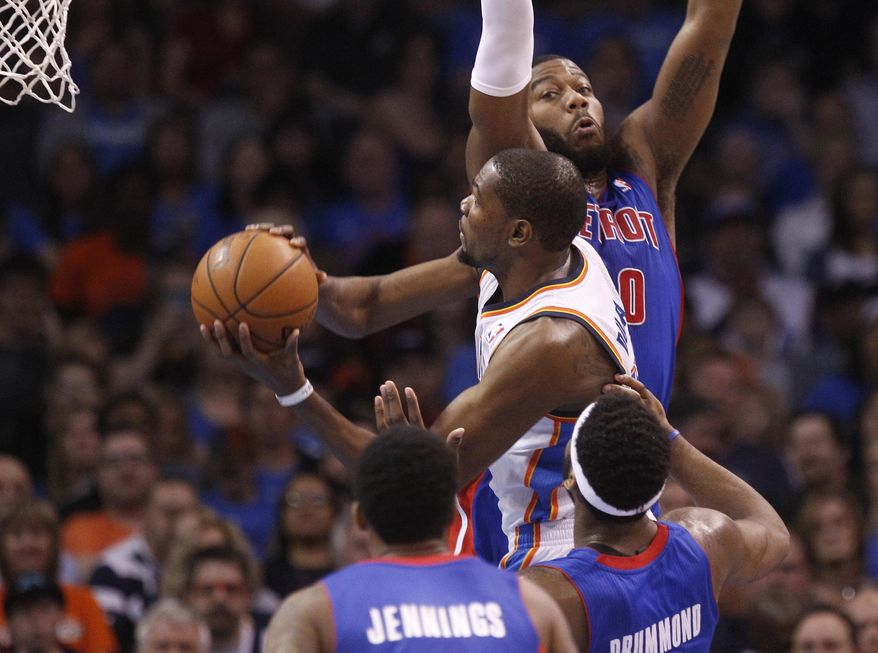 Oklahoma City Thunder forward Kevin Durant (35) goes up for a shot in front of Detroit Pistons guard Brandon Jennings, front, center Andre Drummond and forward Greg Monroe (10) during the first quarter of an NBA basketball game in Oklahoma City, Wednesday, April 16, 2014. (AP Photo/Sue Ogrocki)