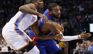 Detroit Pistons forward Greg Monroe drives around Oklahoma City Thunder forward Serge Ibaka during the first quarter of an NBA basketball game in Oklahoma City, Wednesday, April 16, 2014. (AP Photo/Sue Ogrocki)