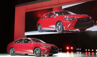 The 2015 Toyota Camry is introduced at the New York International Auto Show, Wednesday, April 16, 2014, in New York. (AP Photo/Mark Lennihan)