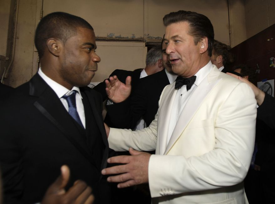 "**FILE** Alec Baldwin (right) and Tracy Morgan are seen backstage after ""30 Rock"" won the award for outstanding comedy series at the 59th Primetime Emmy Awards at the Shrine Auditorium in Los Angeles on Sept. 16, 2007. Billy Baldwin is at rear right. (Associated Press)"