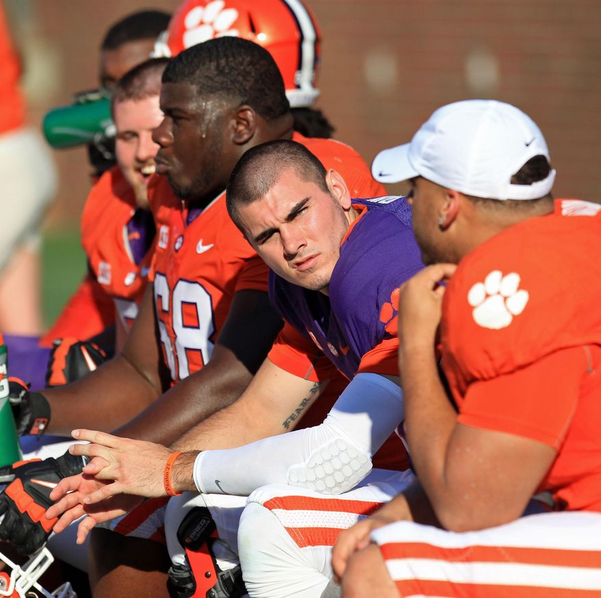 Clemson quarterback Chad Kelly, center, sits on the bench during the second half of the Tigers' NCAA college football spring game at Memorial Stadium in Clemson, S.C. on Saturday, April 12, 2014. Head coach Dabo Swinney announced on Monday, April 14,  that Kelly was dismissed from the team. (AP Photo/Anderson Independent-Mail, Mark Crammer) GREENVILLE NEWS - OUT; SENECA JOURNAL - OUT