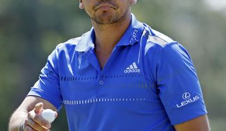 Jason Day, of Australia, holds up his ball after putting on the eighth hole during the third round of the Masters golf tournament Saturday, April 12, 2014, in Augusta, Ga. (AP Photo/Matt Slocum)