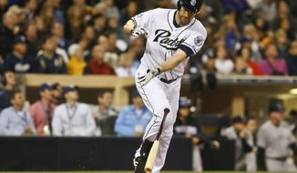 San Diego Padres' Chase Headley throws his bat in disgust after flying out with the tie run in scoring position in the sixth inning of a baseball game against the Colorado Rockies Tuesday, April 15, 2014, in San Diego.  (AP Photo/Lenny Ignelzi)