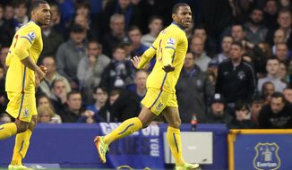 Crystal Palace's Jason Puncheon, right, celebrates scoring their first goal of the game against Everton during their English  Premier League match at Goodison Park, Liverpool, England  Wednesday April 16, 2014. (AP Photo/Barry Coombs/PA) UNITED KINGDOM OUT