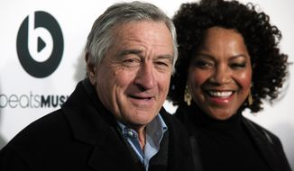 "Tribeca Film Festival co-founder and actor Robert De Niro, left, with his wife Grace Hightower, attends the world premiere of ""Time Is Illmatic"" at the 2014 Tribeca Film Festival on Wednesday, April 16, 2014, in New York. (Photo by Andy Kropa/Invision/AP)"