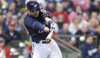 Milwaukee Brewers' Jonathan Lucroy hits a two RBI single off of St. Louis Cardinals' Seth Maness during the fifth inning of a baseball game Wednesday, April 16, 2014, in Milwaukee. (AP Photo/Tom Lynn)