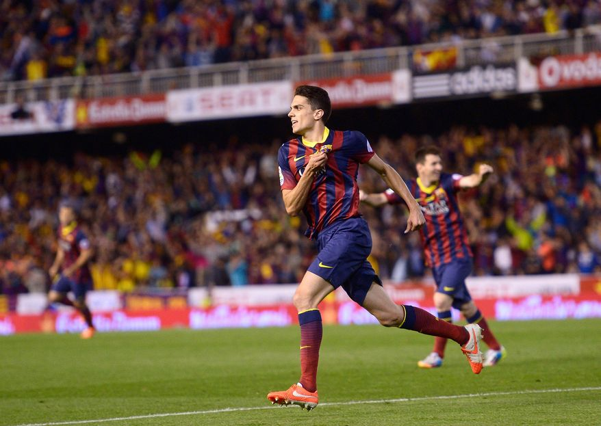 Barcelona's Marc Bartra celebrates after scoring his side's first goal during the final of the Copa del Rey between FC Barcelona and Real Madrid at the Mestalla stadium in Valencia, Spain, Wednesday, April 16, 2014. (AP Photo/Manu Fernandez)