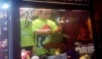 Nebraska toddler Kael Ireland was found playing with toys inside the Bear Claw arcade game. Photo: WOWT/Nebraska