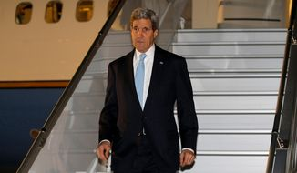 Secretary of State John Kerry arrives in Geneva, Wednesday, April 16, 2014, where he is scheduled to participate in talks on the ongoing situation in Ukraine with representatives from Ukraine, Russia and the European Union. (AP Photo/Jim Bourg, Pool)