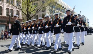 Members of the United States Marine Corps Marching Platoon march along Pennsylvania Avenue during the annual Emancipation Day Parade on Wednesday, April 16.  halid Naji-Allah /Special to The Washington Times