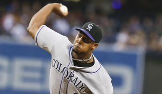 Colorado Rockies starting pitcher Juan Nicasio works against the San Diego Padres in the first inning of a baseball game Tuesday, April 15, 2014, in San Diego. (AP Photo/Lenny Ignelzi)