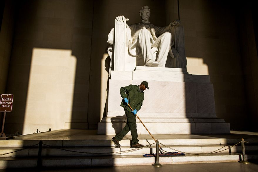 "WASHINGTON, DC - APRIL 16: Washington, DC maintenance worker Corey Felder cleans the Lincoln Memorial in the early morning of April 16, 2014. ""I love it,"" said Felder, who has worked as a maintenance worker for 19 years, 3 of which at the Lincoln Memorial. "" It's a beautiful job; I honor this whole facility; I like what I do and it's good to meet so many people from all over."" (Eva Russo/Special to The Washington Times)"