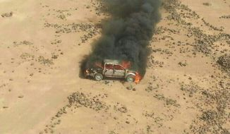 This aerial photo shows a truck burning after a Jordanian air strike on a convoy at the border between Jordan and Syria on Wednesday, April 16, 2014. Jordanian military warplanes struck a convoy of vehicles as they were trying to enter Jordan from Syria, the army said in a statement Wednesday, in an unusual move at a time of tensions between the desert kingdom and Damascus.(AP Photos/Ammonnews)
