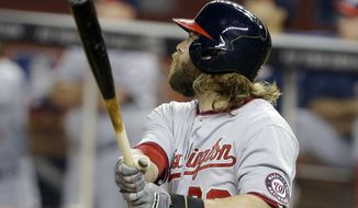 Washington Nationals' Jayson Werth watches after hitting a three-run during the sixth inning of the MLB National League baseball game against the Miami Marlins, Wednesday, April 16, 2014, in Miami. (AP Photo/Lynne Sladky)