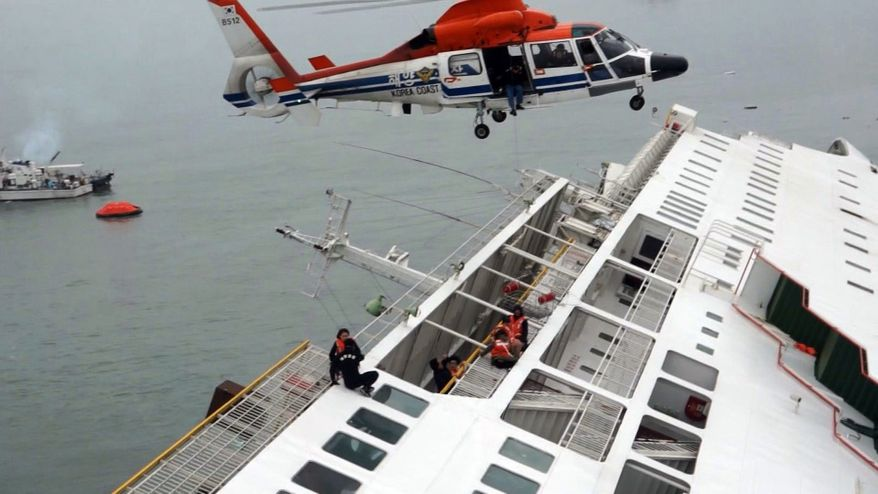 In this image taken from video released by News Y via Yonhap, passengers from a ferry sinking off South Korea's southern coast, are rescued by a South Korean Coast Guard helicopter in the water off the southern coast near Jindo, south of Seoul, Wednesday, April 16, 2014. Nearly 300 people were still missing Wednesday several hours after the ferry carrying 477, most of them high school students, sank in cold waters off South Korea's southern coast. (AP Photo/Yonhap) KOREA OUT