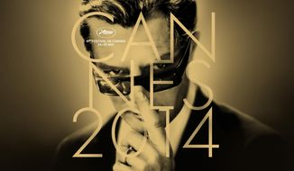 "This photo provided Tuesday, April 15, 2014, by the Festival de Cannes shows the official poster of the 67th International Film Festival of Cannes. The poster showing actor Marcello Mastroianni is based on Federico Fellini 1963 film ""8 1/2"".  The festival will run from May 14 to 25, 2014. (AP Photo/Festival De Cannes)"