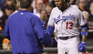Los Angeles Dodgers' Hanley Ramirez reacts after being hit by a throw from San Francisco Giants' Ryan Vogelsong during the seventh inning of a baseball game on Wednesday, April 16, 2014, in San Francisco. (AP Photo/Marcio Jose Sanchez)