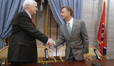 Lt. Gov. Ron Ramsey, R-Blountville, left, shakes hands with Tennessee Gov. Bill Haslam after a news conference on the final day of the 108th General Assembly on Thursday, April 17, 2014, in Nashville, Tenn. (AP Photo/Mark Humphrey)