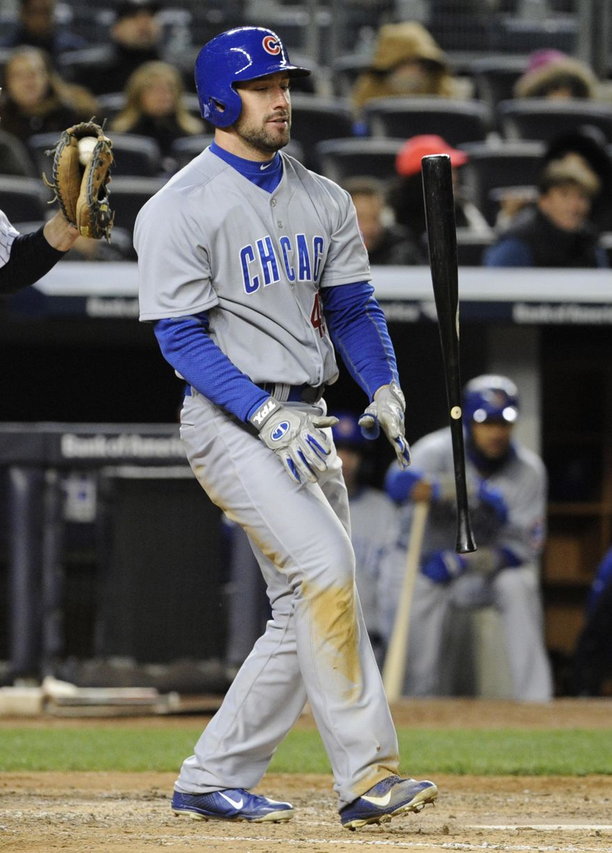 Chicago Cubs' Ryan Kalish flips his bat after striking out during the fifth inning of Game 2 of an interleague baseball doubleheader against the New York Yankees, Wednesday, April 16, 2014, at Yankee Stadium in New York. (AP Photo/Bill Kostroun)