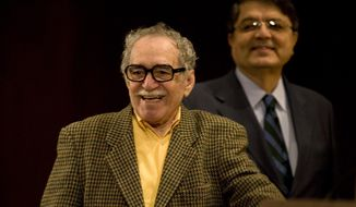 FILE - In This Nov. 18, 2008, file photo, Colombian Nobel Literature laureate Gabriel Garcia Marquez and Nicarguan author and former Vice President Sergio Ramirez, attend a round table discussion on Mexican writer Carlos Fuentes' work at the UNAM national university in Mexico City.  Garcia Marquez died Thursday April 17, 2014 at his home in Mexico City. (AP Photo/Dario Lopez-Mills)