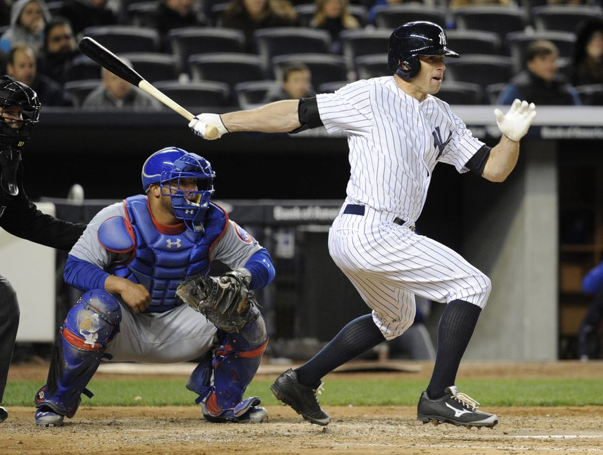 New York Yankees' Brett Gardner, right, hits an RBI-single as Chicago Cubs catcher Welington Castillo, left, looks on during the fourth inning of Game 2 of an interleague baseball doubleheader on Wednesday, April 16, 2014, at Yankee Stadium in New York. (AP Photo/Bill Kostroun)