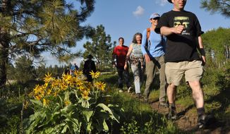 In this 2010 photo, Chuck Huber and a group of Spokane Mountaineers enjoy an after-work hike through the Slavin Conservation Area south of Spokane, Wash.  (AP Photo/The Spokesman-Review, Rich Landers)  COEUR D'ALENE PRESS OUT