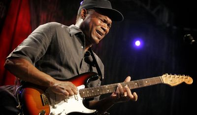 """Blues icon Robert Cray performs with his signature Fender Stratocaster at a concert in Anaheim, Calif. on Saturday, Jan. 17, 2009. He says, """"I use the Stratocaster because it has the sound I'm looking for and then some. It's surprising what sounds and tones comes out of the Stratocaster. It is such a simply built guitar, it's a workhorse."""" (AP Photo/Matt York)"""