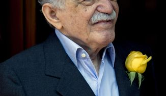 FILE - In this March 6, 2014 file photo, Colombian Nobel Literature laureate Gabriel Garcia Marquez greets fans and reporters outside his home on his 87th birthday in Mexico City. Garcia Marquez died Thursday April 17, 2014 at his home in Mexico City. The author's magical realist novels and short stories exposed tens of millions of readers to Latin America's passion, superstition, violence and inequality. (AP Photo/Eduardo Verdugo, File)